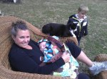 catie harts field with grandchildren and cat
